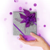 Woman hand and kraft gift box with pink bow on pink background decorated with confetti.. Top view, holiday present concept.